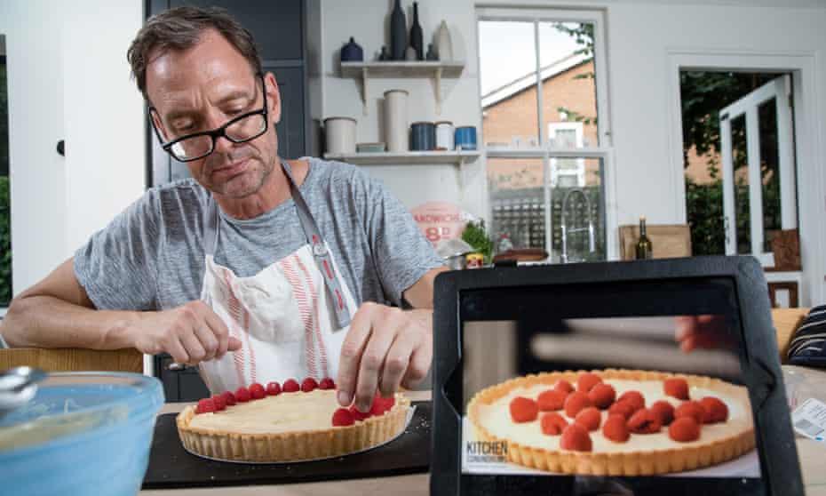 Tim Dowling following Thomas Joseph's YouTube tutorial for a raspberry tart.