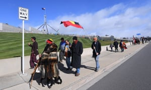 Clinton Pryor (second from left) walks around Parliament House prior to meeting with the prime minister.