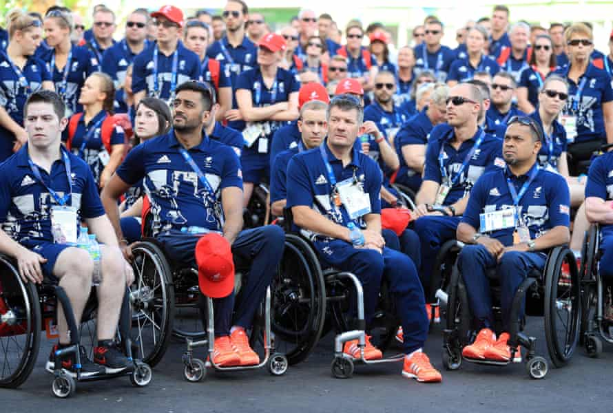 The Paralympic GB team watch the Welcome Ceremony at the Athletes Village.