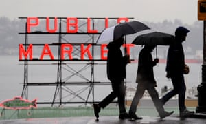 At the Pike Place market in Seattle, Washington, pedestrians huddle under rain hoods and umbrellas. Data may show that Seattle is not one of the rainiest cities in the US, but residents can take heart that it remains one of the dreariest.