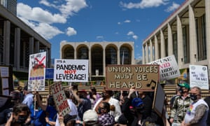 Demonstrators, including locked out stagehands, backstage workers, musicians, opera singers and supporters of The Metropolitan Opera protest during the 'We Are the Met Rally'outside Lincoln Center Plaza in New York City.