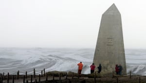 Visitors are buffeted by gale-force winds at Portland Bill, near Southwell, Dorset