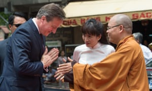 David Cameron is greeted by a Buddhist monk in Ho Chi Minh City, Vietnam.