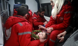 Syrian staff from the ICRC evacuate a baby in Douma, in the eastern Ghouta region of Syria