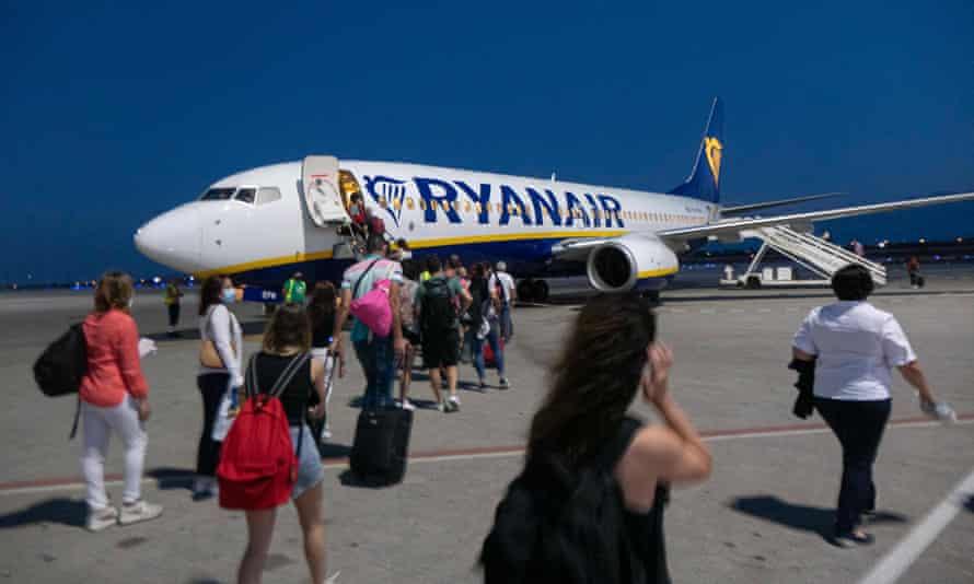 Passengers board a Ryanair plane in Greece last month