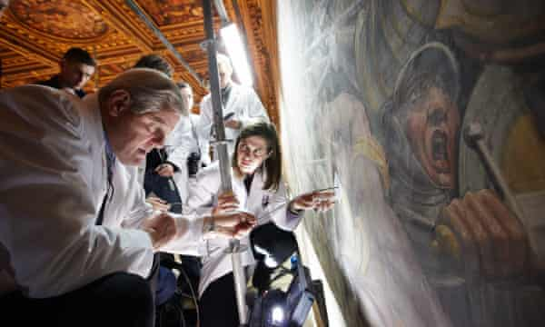 Art experts probe a wall at the Palazzo Vecchio in 2012, in search of Leonardo's fresco.