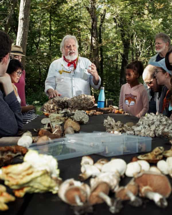 Mycologist Paul Sadowski speaks with members of the New York Mycological Society.
