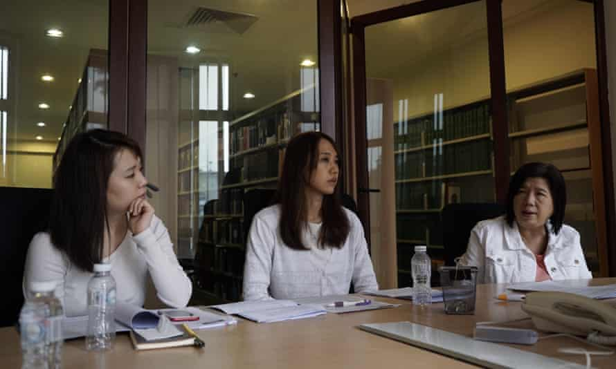 Pastor Raymond Koh's wife Susanna Liew (right) and their daughters Esther (centre) and Elizabeth Koh speaks to the Guardian in an interview on 23 May following a press conference on the 100th day of the pastor's disappearance.