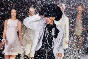A catwalk snowstorm for Chanel's Autumn/Winter 2003/04 ready-to-wear collections in Paris