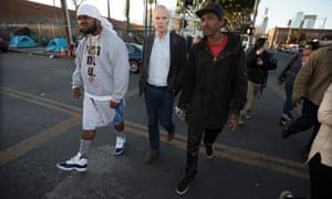 Philip Alston on a tour of an area with a high level of homelessness in Los Angeles.