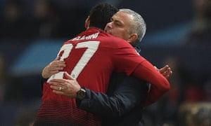Manchester United's Marouane Fellaini celebrates scoring the opening goal with Manchester United's manager Jose Mourinho.