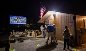 People wait in the socially distanced line for the snack bar during the intermission of a double feature movie at the Tiger Drive-In theater in the tiny mountain town of Tiger, Georgia, last Friday.