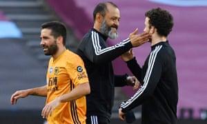 Wolverhampton Wanderers manager Nuno Espirito Santo celebrates with Diogo Jota .