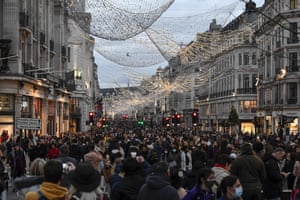 Crowds of shoppers walk under the Christmas lights in Regent Street, in London, Saturday, 12 December, 2020. The British health secretary Matt Hancock says infections are starting to rise in some areas after falling during a four-week national lockdown in England that ended on 2 December.