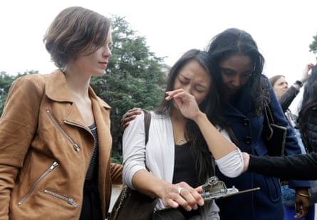 University of California graduate student Kathleen Gutierrez, center, is comforted by graduate student Erin Bennett, left, and Tyann Sorrell before all spoke at a news conference about sexual harassment claims.