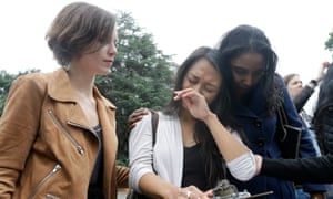Graduate students Kathleen Gutierrez (center) and Erin Bennett (left) speak at an emotional news conference on campus in April. Both filed sexual harassment complaints against the professor.