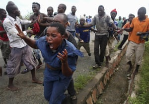 <strong>Bujumbura, Burundi</strong> People attack a police officer accused of shooting a protestor in the Buterere neighbourhood. Protestors opposed to the president's decision to run for a third term chased, beat and stoned the officer before handing her back to police