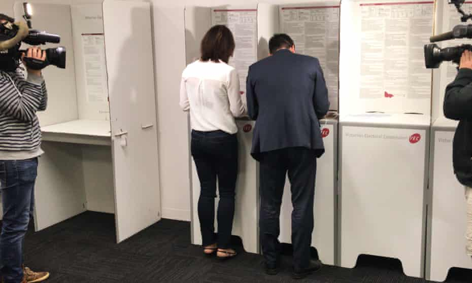 The Victorian opposition leader, Matthew Guy, and his wife, Renae, cast their vote at a pre-polling booth in his Bulleen electorate in Melbourne on Wednesday.