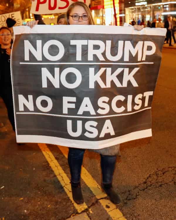 A protester in Chicago with banner