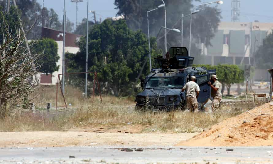 Government fighters exchange fire with Khalifa Haftar's Libyan National Army in Espiaa, near Tripoli, on 29 April.