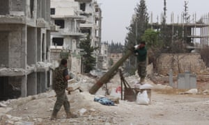 Members of a Syrian opposition group prepare an attack on regime positions in Aleppo