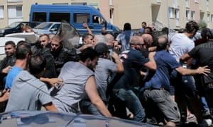 Riot police hold back protesters in Lupino, Corsica