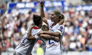 Lyon's Delphine Cascarino celebrates with Ada Hegerberg after scoring the first via an own goal.