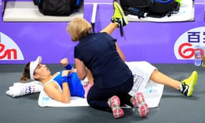 Belinda Bencic receives treatment for the injury that eventually cost her the match.