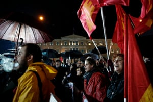 Supporters of the Greek Communist Party shout slogans as they listen to a speech by General Secretary of the party Dimitris Koutsoubas (not pictured) under rainfall in front of the parliament building in Athens February 27, 2015.