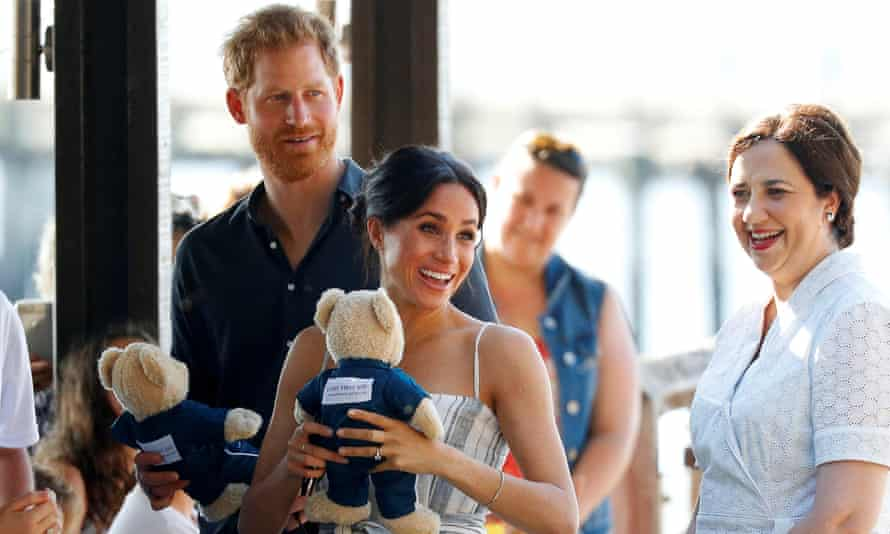 Prince Harry and Meghan, with the premier, Annastacia Palaszczuk, hold teddy bears as they greet members of the public in Kingfisher Bay.