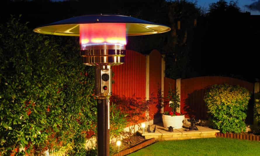 An outdoor gas heater in a garden