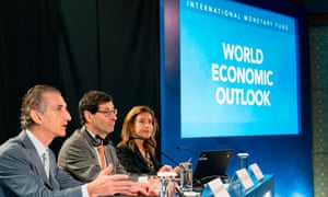 The IMF deputy director, Gian Maria Milesi-Ferretti, chief economist Maurice Obstfeld and communications officer Wafa Amr answer questions at the World Economic Outlook press conference in Bali.