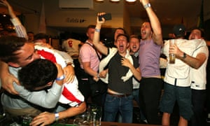 England supporters celebrate at the Lord Raglan Pub in London as England play Tunisia.