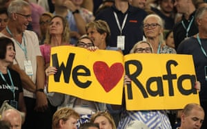 Spectators hold up banners of support for Rafael Nada