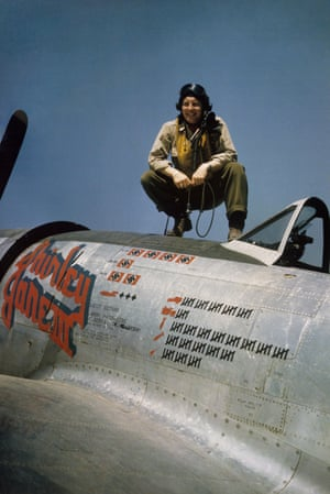Captain Edwin 'Bill' Fisher of the 377th Fighter Squadron, 362nd Fighter Group, atop his P-47D Thunderbolt Shrley Jane III at a landing ground in France in summer 1944