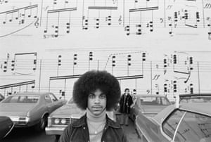 'This is to me the most iconic photo of my collection. It's totally about Prince and Minneapolis; if you are from Minneapolis you will understand the vibe even better. I love the fact that it was shot in the landscape format. The cropping is very powerful. The way your eye goes directly to Prince and than the cars, the woman in the back who did not move for long time and of course the music wall. In this series you will find other expressions that he gave to the camera, but the intensity was in this one time shot'