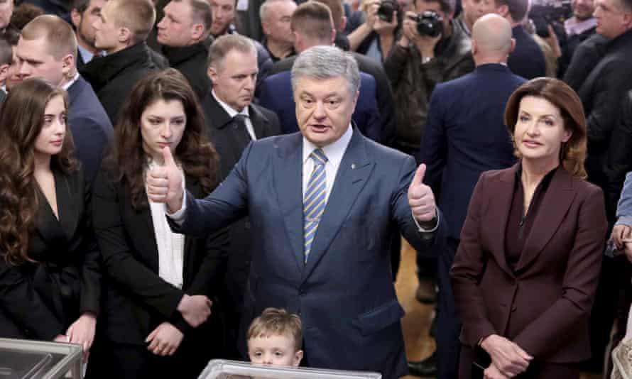 Ukraine's president, Petro Poroshenko, accompanied by his family at the polling station during Sunday's first-round elections
