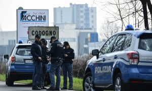 Italian National Police officers patrol on February 23, 2020 at the entrance of the small Italian town of Codogno, under the shadow of a new coronavirus outbreak.