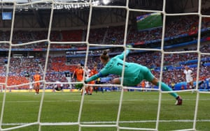 Sari Van Veenendaal of the Netherlands rdives in vain as Rose Lavelle of the USA scores her team's second goal during the 2019 FIFA Women's World Cup Final.