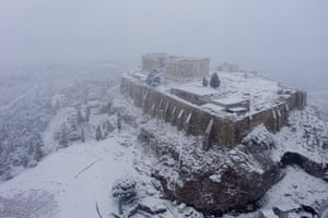 Snow covers the ancient Acropolis hill.