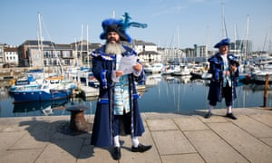 Town crier John Pitt, left, marks the 400th anniversary of the Mayflower's voyage to America.