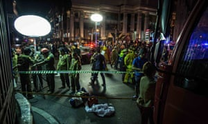 Emergency personnel and investigators gather after a deadly explosion hits central Bangkok