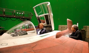 Prince Harry sits in an A-wing fighter and talks to Mark Hamill.