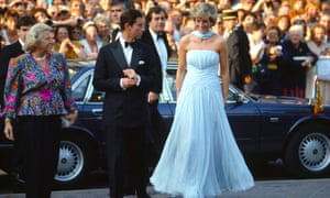 Prince Charles and Princess Diana arriving at the Cannes film festival in May 1987. Her pale blue chiffon gown with matching stole were designed by Catherine Walker.