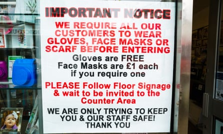 A sign in a shop in Falmouth, Cornwall, warning customers to wear gloves and face coverings