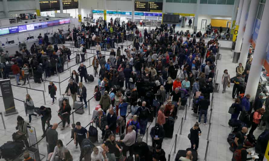 People queue at Gatwick airport