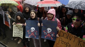 Other young demonstrators at the San Francisco rally braved the rain to shout slogans and display creative posters