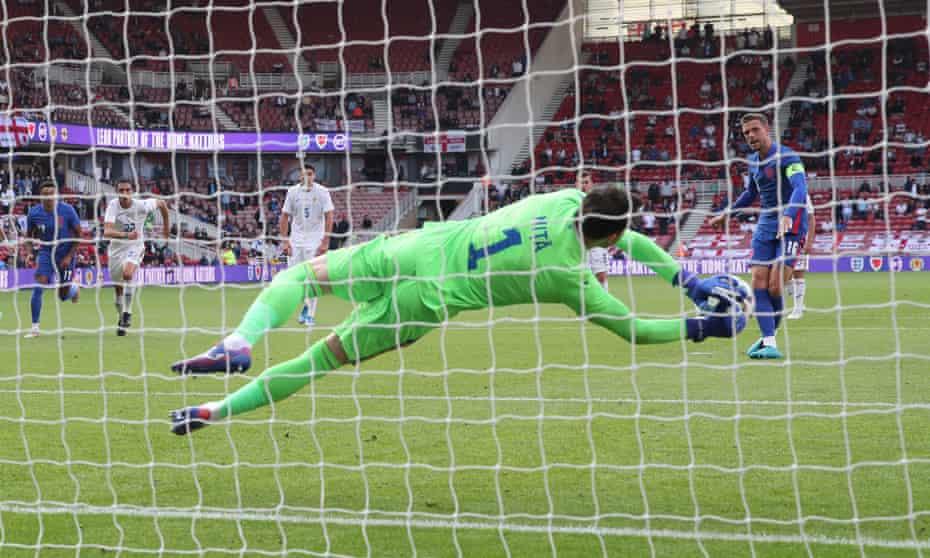 Jordan Henderson of England sees his penalty saved by Romania's goalkeeper Florin Nita.