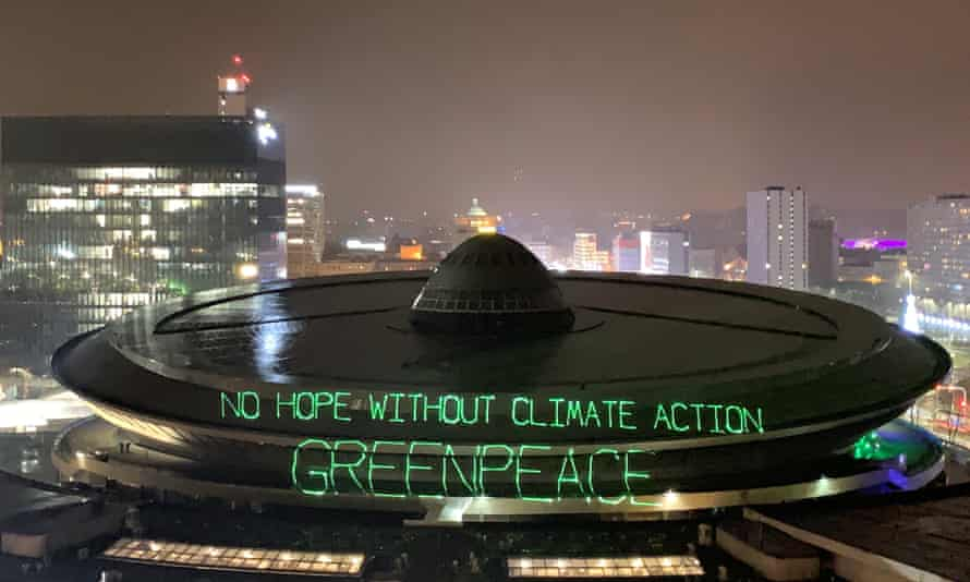"""Greenpeace activists project words """"No hope without climate action"""" on the roof of the venue of the COP24 conference in Katowice, Poland"""