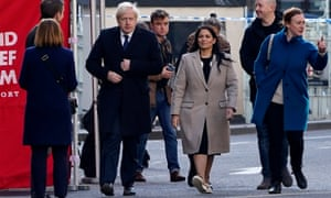 Boris Johnson and the home secretary Priti Patel at the scene of the London Bridge stabbings.